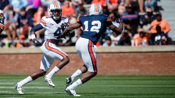 Auburn wide receiver Jason Smith (4) runs downfield as Auburn defensive back Jamel Dean (12) goes to tackle him during Auburn's NCAA spring college football game Saturday, April 9, 2016, in Auburn, Ala. 