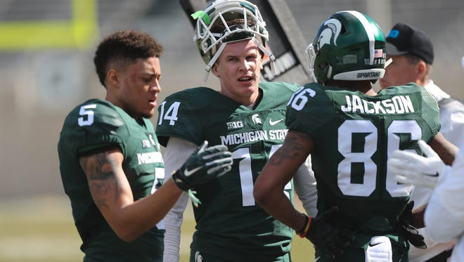 Trishton Jackson, right, is likely to be MSU quarterback Brian Lewerke's (center) top target this season. Freshman Hunter Rison could be in the mix, too.