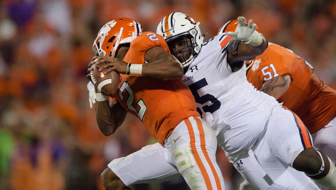 Auburn defensive lineman Dontavius Russell (95) sacks Clemson quarterback Kelly Bryant (2) during the NCAA football game between Auburn and Clemson on Saturday, Sept. 9, 2017, in Clemson N.C.