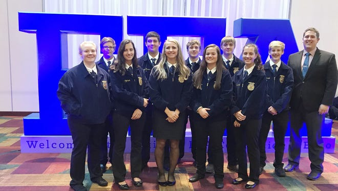 At the national FFA convention are, in front: Kamryn Hoskey, Katelyn Cook, Hope Brecht, Tori Hlas and Hannah Cook. In back are Cole Carlson, John Reekers, Keaten Hoskey, John Kolash, Carson Adams and Mr. Eskildsen.