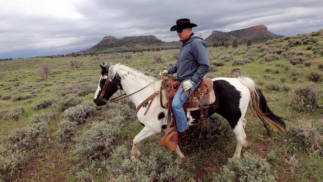In this May 9, 2017, file photo, Interior Secretary Ryan Zinke rides a horse in the new Bears Ears National Monument near Blanding, Utah. Much of Bears Ears is on land administered by the Bureau of Land Management, which is part of Zinke's department. Western lawmakers are arguing that BLM headquarters should be moved from Washington, D.C., to the West because of its influence there.