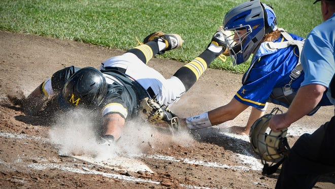 Cathedral catcher Sam Schneider tags Derrick Winn of Duluth Marshall at the plate during the state Class 2A quarterfinals Thursday, June 14, at Dick Putz Field in St. Cloud.