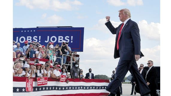 PRESIDENT DONALD TRUMP arrives during a visit to Basler Flight Service on Monday, Aug. 17, at Wittman Regional Airport in Oshkosh, Wis. The president flew to Oshkosh following his visit at the Mankato Regional Airport.