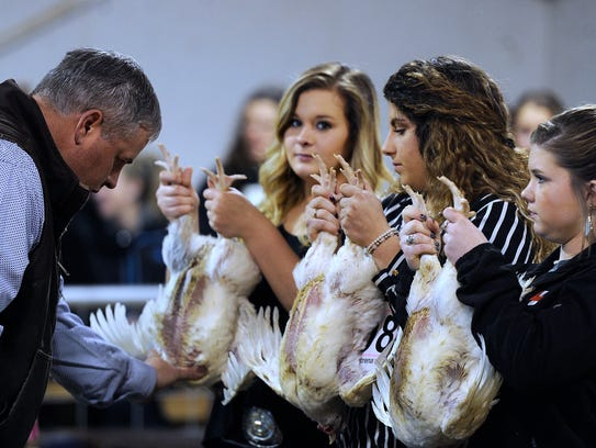 Participants show off their poultry during the Wylie