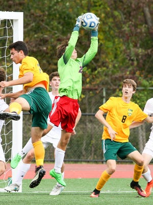 Mendham sophomore Jack Journeycake makes the save against Morris Knolls during a Morris County Tournament semifinal.