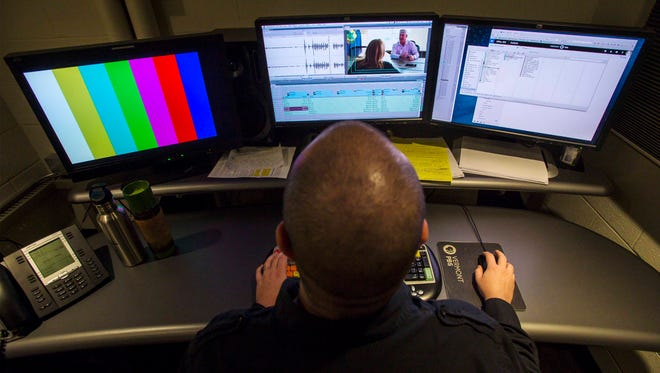 """Production Technician Holt Albee edits an episode of the new """"Innovate"""" program at the Vermont PBS studios in Colchester on Monday, October 10, 2016."""