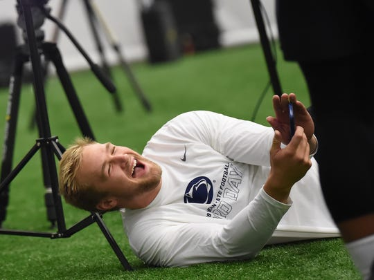 Former Penn State player Mike Gesicki laughs after