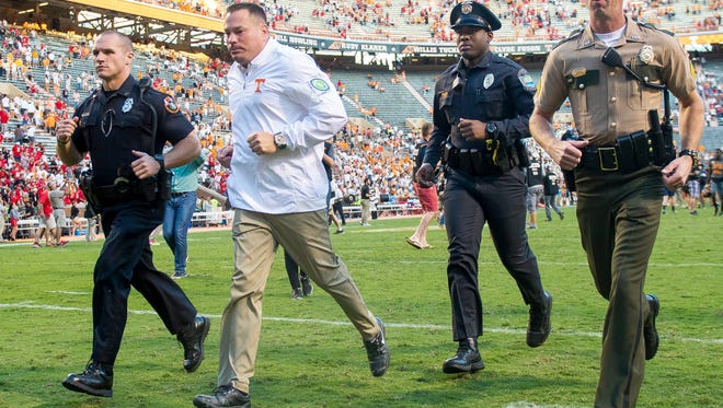 Tennessee Head Coach Butch Jones runs into the locker room after Tennessee's game against Georgia in Neyland Stadium on Saturday, Sept. 30, 2017.
