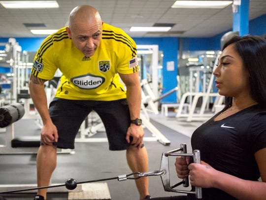 Fitness trainer Johnny Jimenez coaches client Stefanie Hernandez at the Las Cruces Fitness Center. Jimenez also  advises on nutrition and helps clients develop varied workout routines.
