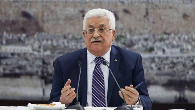 Palestinian President Mahmoud Abbas talks during a leadership meeting in Ramallah, Tuesday, April 1, 2014