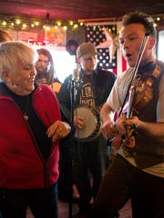 Sun., Feb. 5, 2017:  Rita Brooks of Covington, 71, dances with Slippery Creek's fiddler Harry Pedigo of Fairfax, Ohio.