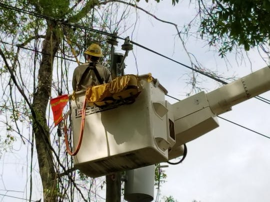City of Tallahassee Utility crews work to restore power Sunday.