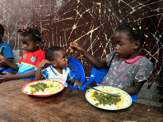 Children eating at an orphanage in the Democratic Republic