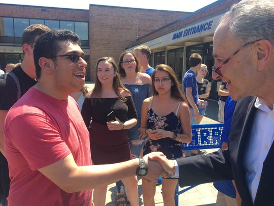 Sen. Chuck Schumer speaks with educators, students and families in Webster about his concerns in the e-cig industry.
