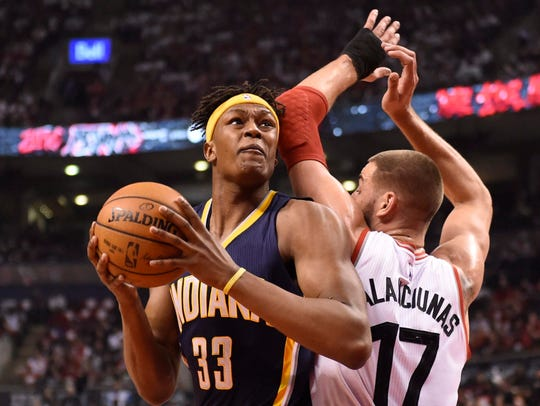 Indiana Pacers' Myles Turner (33) moves around Toronto