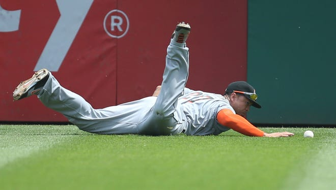 Marlins right fielder Giancarlo Stanton reaches for a ball hit for a double by Pirates center fielder Andrew McCutchen.