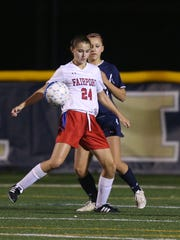 Fairport's Claire Myers tries to control the ball.
