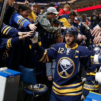 Buffalo Sabres right winger Brian Gionta  greets fans