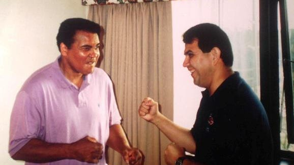 Journal Star bowling columnist Johnny Campos shadow boxes with Muhammad Ali during an impromptu visit on August 9, 1995, at the Louisville Marriott hotel.