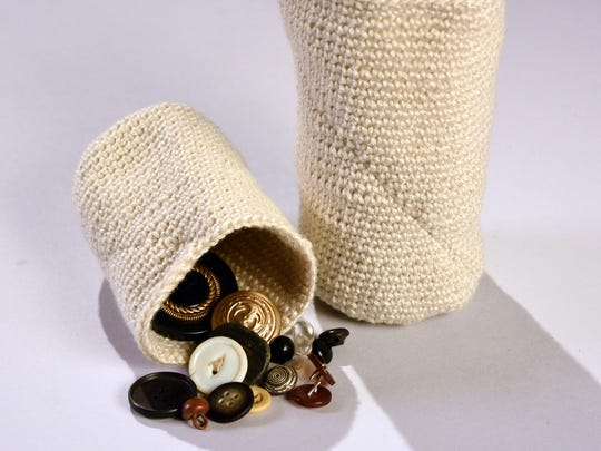 Knitted button holders by Dorothy Albertini are part of the group exhibit.