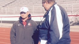 Clinton Township Chippewa Valley football coach Scott Merchant, left, oversees practice for a playoff game against Macomb Dakota.