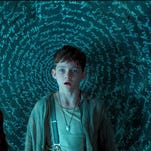 "This photo provided by courtesy of Warner Bros. Pictures shows, Rooney Mara, left, as Tiger Lily, and Levi Miller as Peter, in a scene from the film, ""Pan."" The movie releases in U.S. theaters on Friday, Oct. 9, 2015. (Warner Bros. Pictures via AP)"
