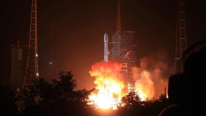 The Long March 3B rocket carrying the Chang'e-3 lunar probe blasts off from the launch pad at Xichang Satellite Launch Center early Dec. 2.