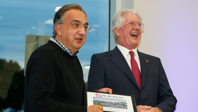 David Fischer, CEO of the Suburban Collection, right, credited Fiat Chrysler CEO Sergio Marchionne with saving Chrysler after it emerged from bankruptcy with the help of loans from  U.S. and Canada taxpayers.