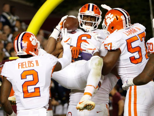 Clemson linebacker Dorian O'Daniel (6) celebrates with his teammates after a pick six during the second half of an NCAA college football game in Blacksburg, Va., Saturday, Sept. 30, 2017. Clemson won the game 31-17. (AP Photo/Steve Helber)
