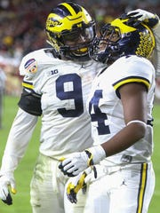 Michigan receiver Josh Metellus, right, and linebacker