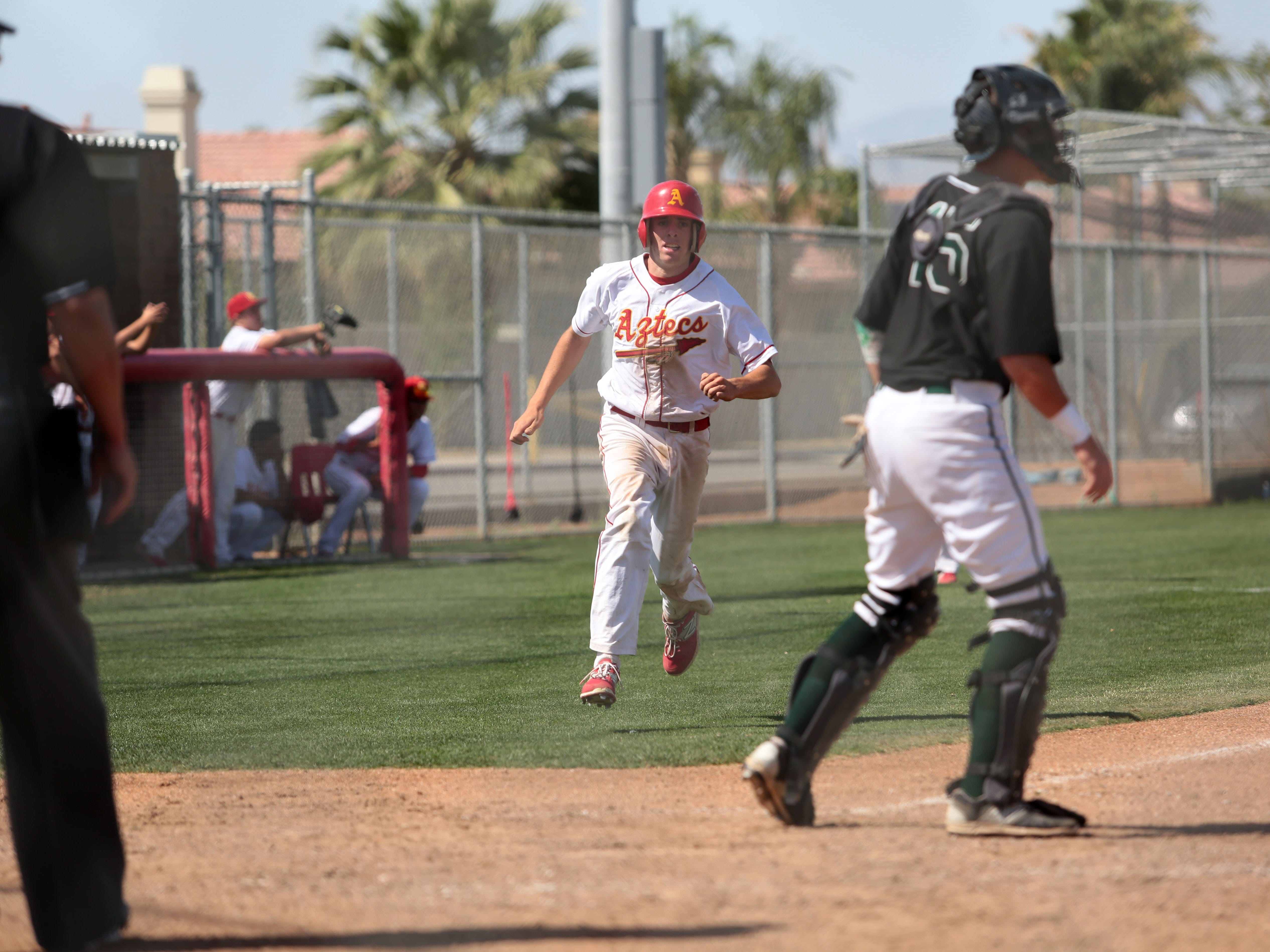 Palm Desert's Andrew Bash makes it home against Royal in the title game of the 53rd annual Coachella Valley Rotary Baseball Classic on Thursday afternoon.