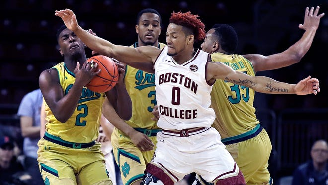 Boston College guard Ky Bowman (0) tries to steal the ball against Notre Dame guard Temple Gibbs (2) during the first half of an NCAA basketball game in Boston, Tuesday, Feb. 14, 2017. (AP Photo/Charles Krupa)