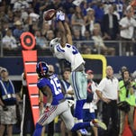 Dallas Cowboys cornerback Brandon Carr (39) misses an interception as New York Giants wide receiver Preston Parker (15) moves in during the first half of an NFL football game Sunday, Sept. 13, 2015, in Arlington, Texas.