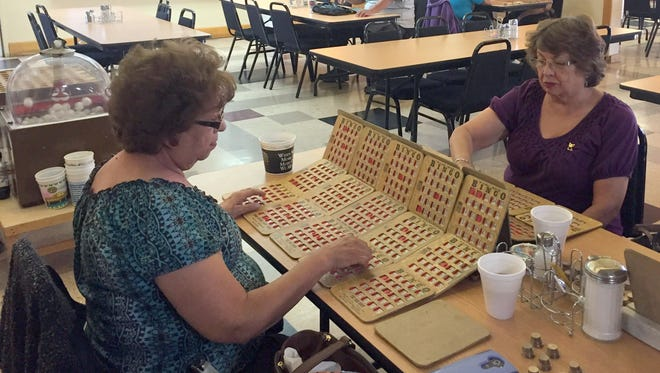 Helen Maldonado, left, and Delia Alvarado play some bingo back in 2017 at the Santa Clara Senior Center. Hot meals are served here weekly for the seniors.