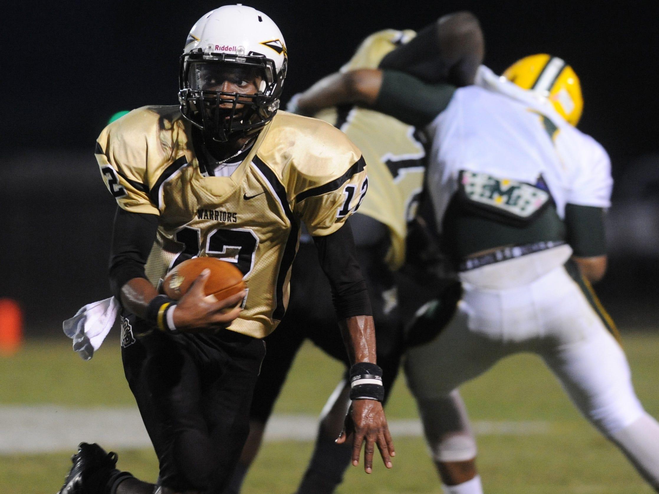 Oak Grove quarterback J.C. Keys (12) runs the ball as the Warriors face McComb Friday night in the Lamar County football jamboree in Sumrall.