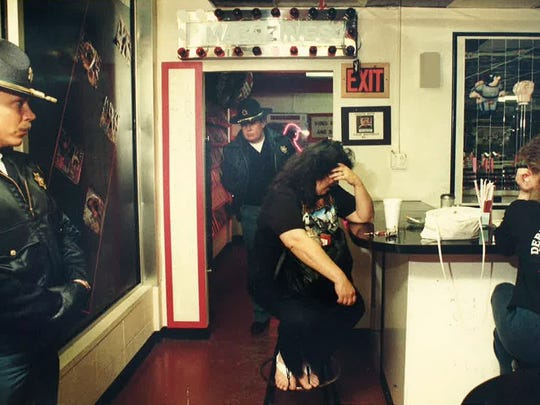 A shot from inside Debbie Duz Donuts when deputies marched in to shut the shop down after its owner was arrested on drug charges in April 1990.