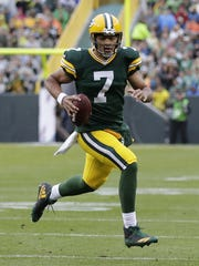 Green Bay Packers quarterback Brett Hundley (7) runs for a touchdown in the first half Sunday, October 22, 2017, at Lambeau Field in Green Bay, Wis.