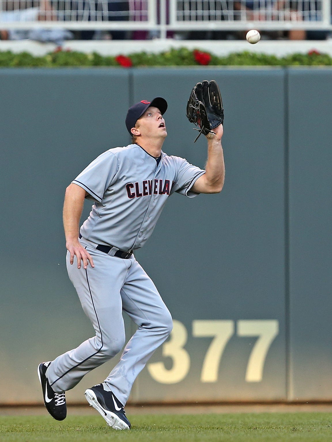 Cleveland Indians left fielder Shelley Duncan (47) catches a fly ball hit in 2012.