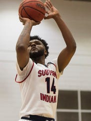 USI's Emmanuel Little (14) takes a jump shot in the