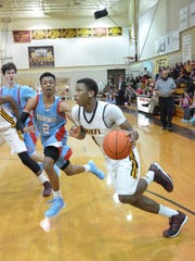 Natchitoches Central junior Brandon Rachal (1, right) drives against Archbishop Rummel during a 2015 game.