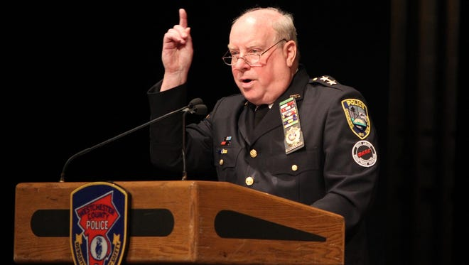Ossining Police Chief Joseph Burton speaks at the Westchester County Police Academy graduation in 2011. He is retiring after 48 years with the department.