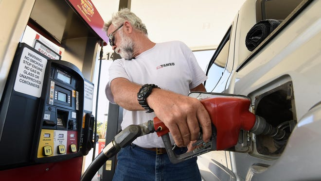 John Snyder of Oakland fills his vehicle with gasoline on Monday. Gas prices are inching downward and could fall below $2 per gallon in Mountain Home by Halloween, according to a petroleum analyst with gasbuddy.com..