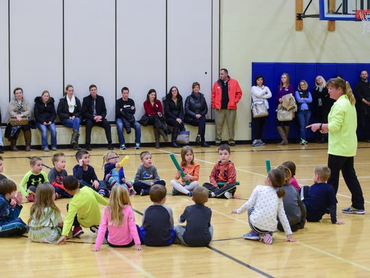 Children gather in a gym. Des Moines Register file photo.
