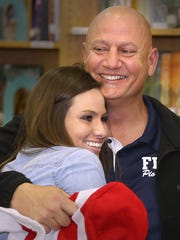 Jimbo Jackson embraces his daughter, Ashley, after