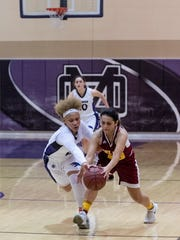 Mission Oak's Kambrayia Elzy, left, pressures Tulare