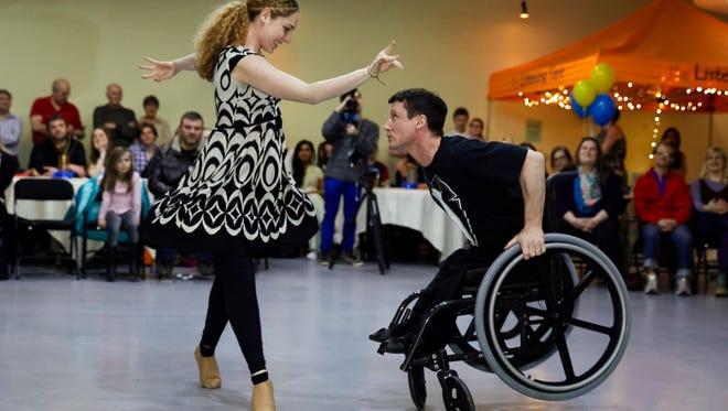 Nicole Agaronnik and Rik Daniels perform a ballroom dance routine.