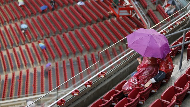 Cincinnati Reds wait out a rain delay before the MLB game between the Cincinnati Reds and the Pittsburgh Pirates, Tuesday, May 10, 2016, at Great American Ball Park in Cincinnati.