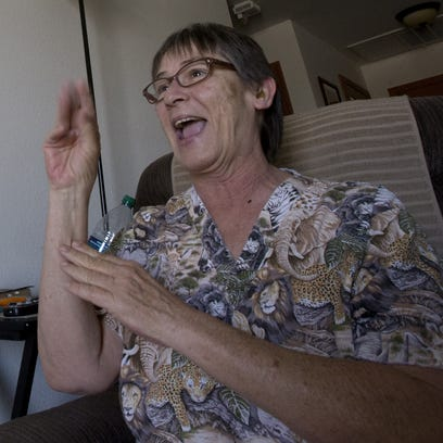 Peggy Sierra, who is hearing-impaired, uses sign language