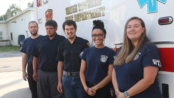 Wayne Township Fire Department's five new EMT's (L-R) Josh Yoder, Dwayne Troyer, Micah Beachy, Sierra Goolsby and Hannah Fantin with the squad at the station.