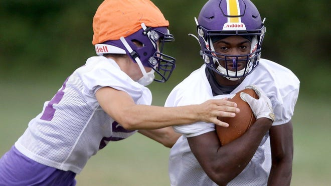Jackson's DJ Harris runs the ball with defense from Andrew Arnold at practice Tuesday morning.